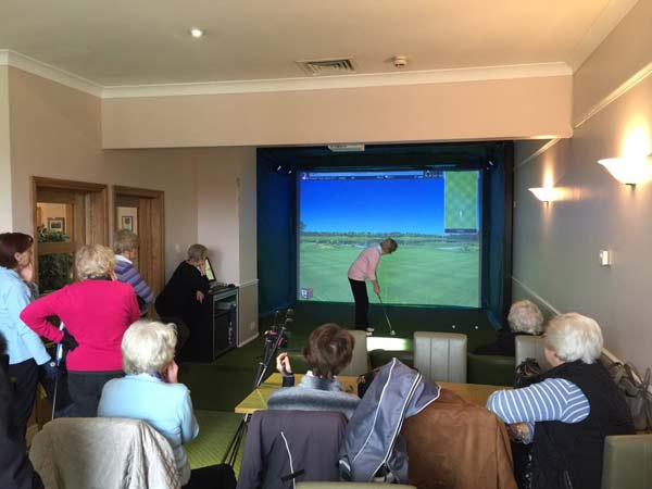 Lady golfers using the Golf Simulator