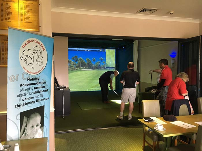 Charity fundraising with a smart golf simulator competition